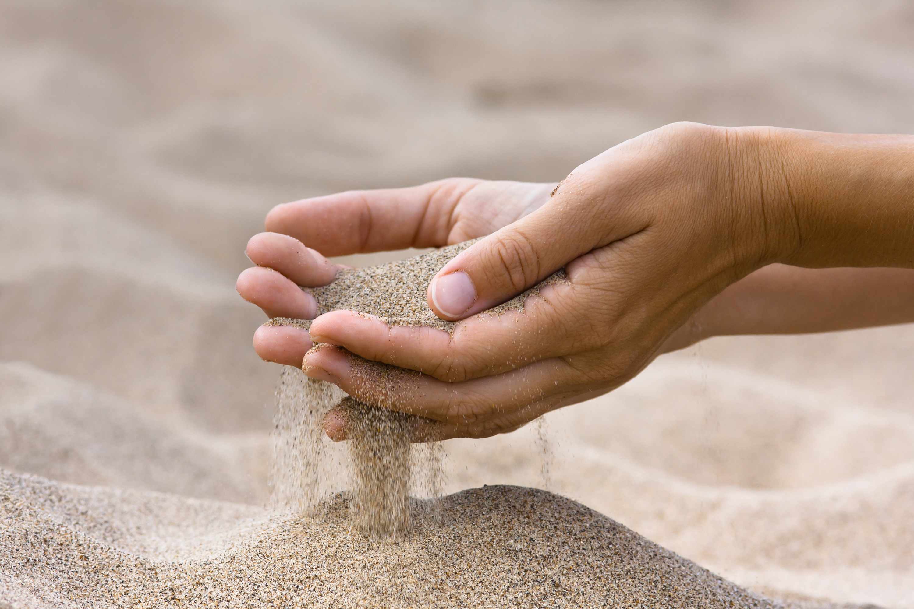 sand running through hands of woman - KnowledgePoint KnowledgePoint